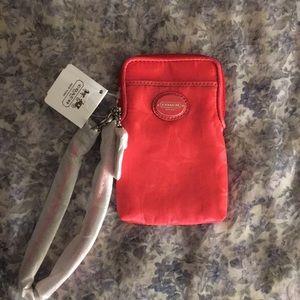 Coach phone case or change wristlet